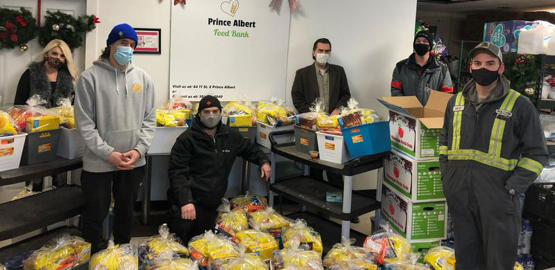 Doug Harvey and Steve Schultz give $3,500 of Food Baskets to the Prince Albert Food Bank